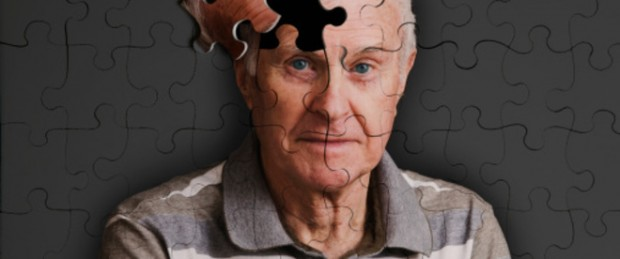 Jigsaw puzzle, of senior man, falling apart